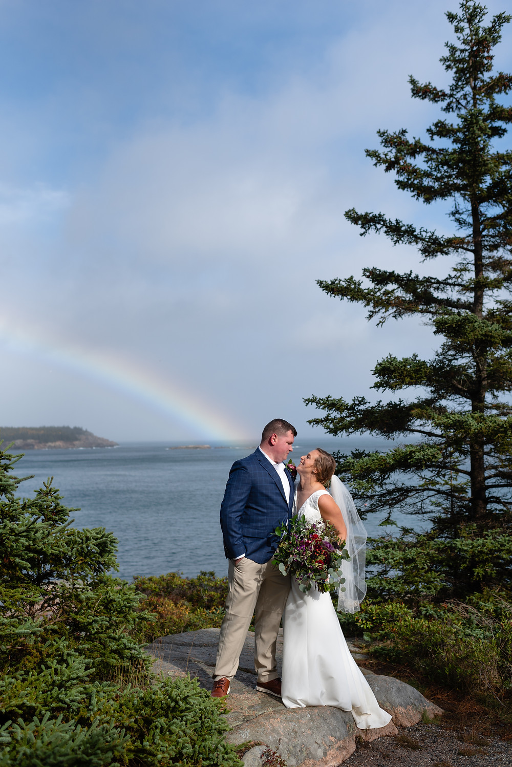 couple with rainbow at gorham mountain trail elopement