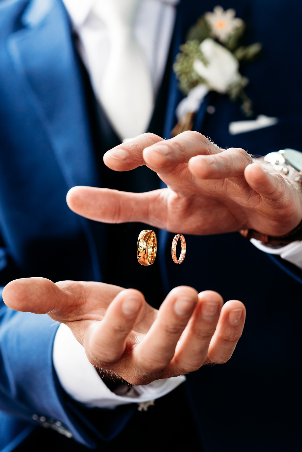 levitating rings between groom's hands