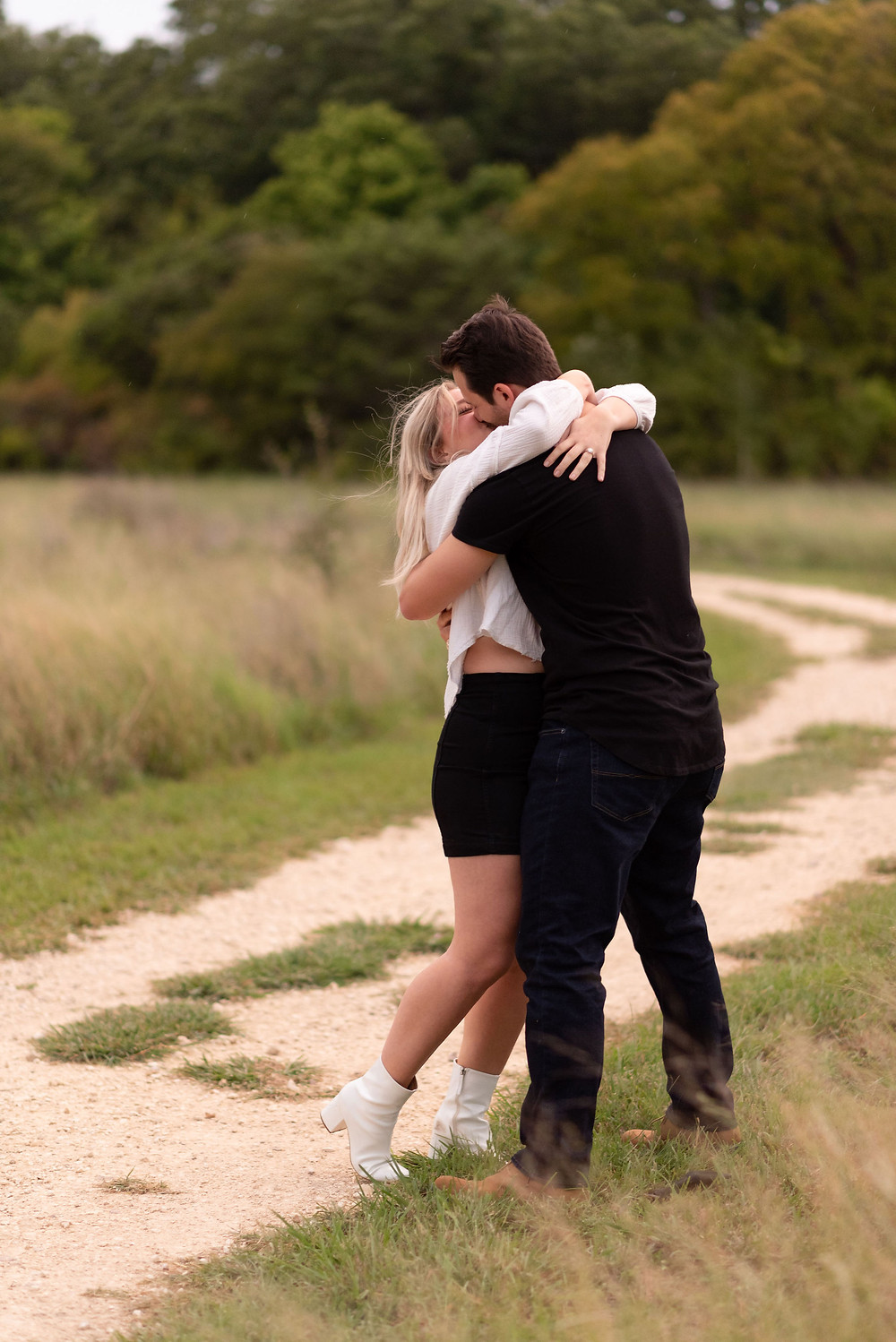 girl embraces her new fiance after saying yes to his proposal