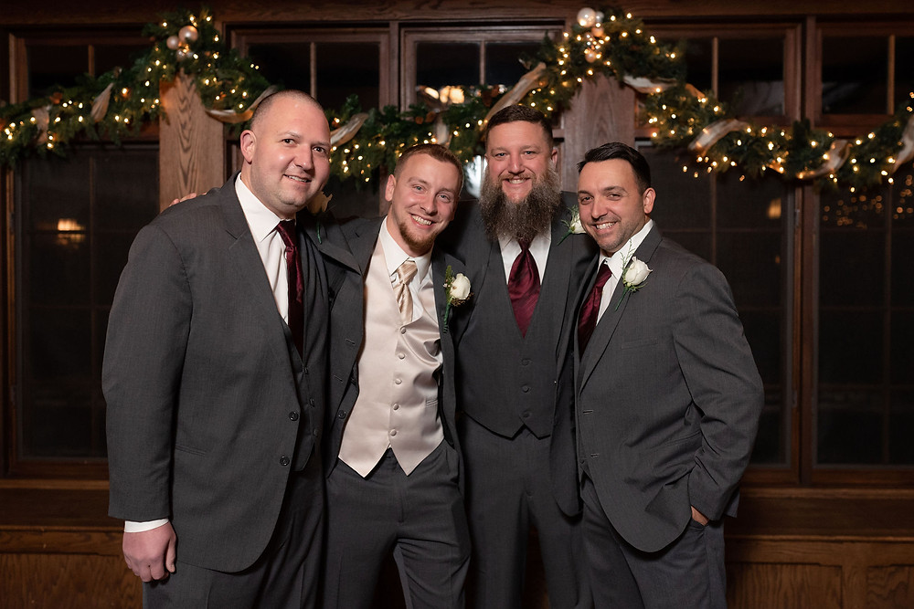 groomsmen wedding photo guys all hugging