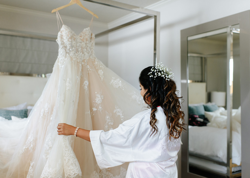 bride interacting with wedding dress