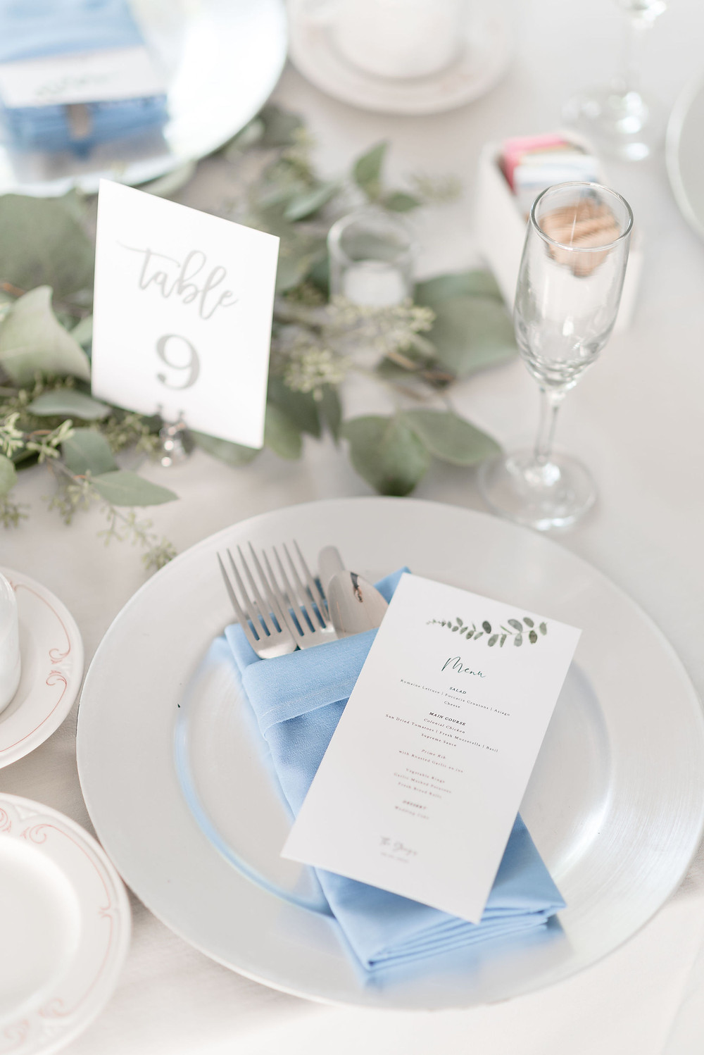 table place setting detail photo with menu, table number, napkins