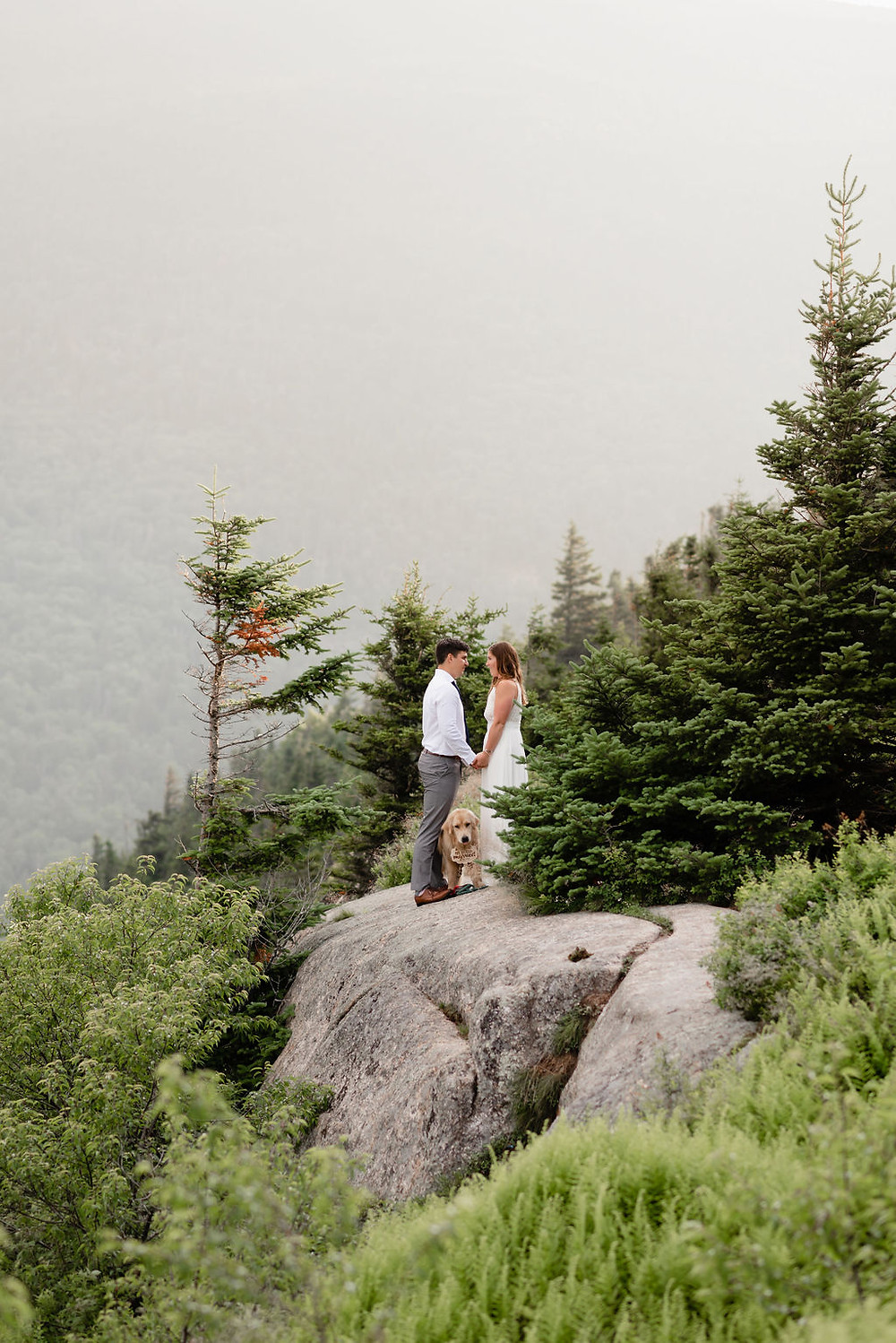 couple saying vows during adventure elopement with their dog