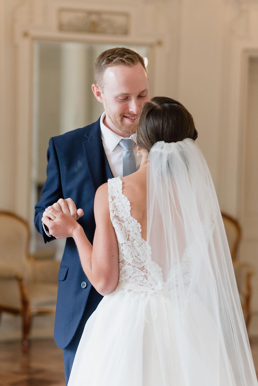 groom peering down at bride smiling