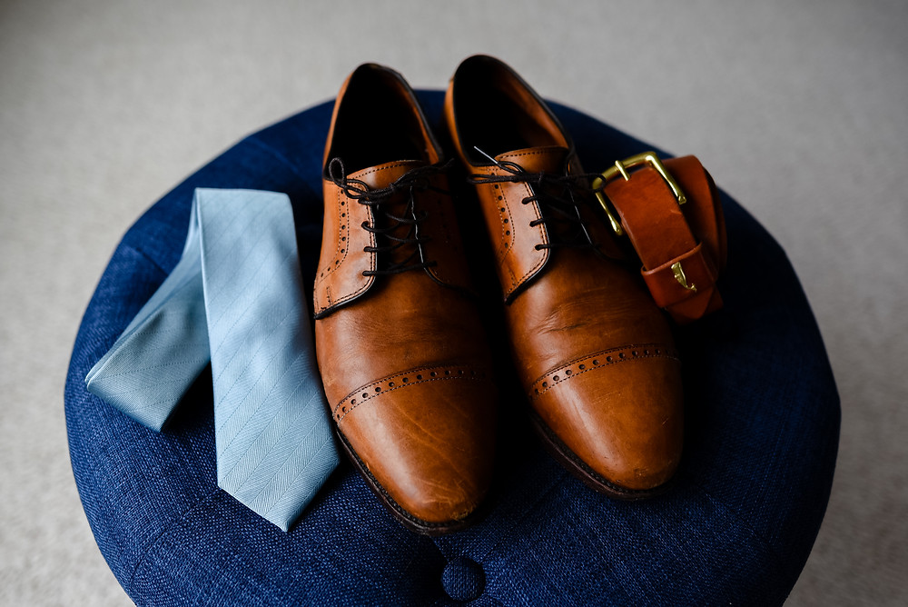 groom's shoes, tie, and belt for wedding day