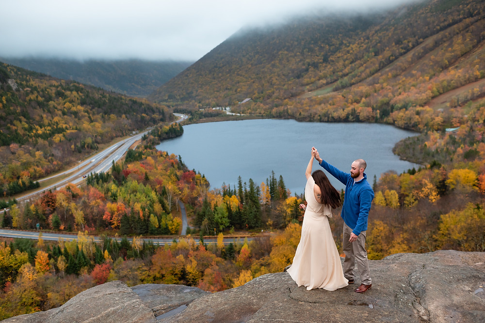 couple dancing at artists bluff with fall foliage