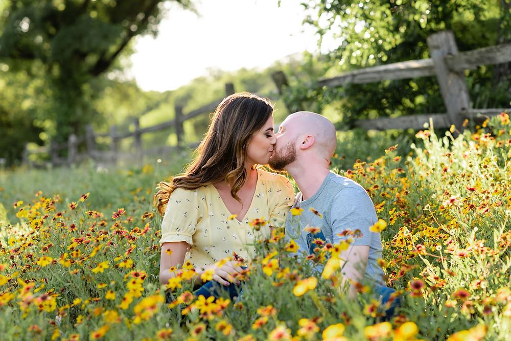 couple kissing in spring wildflowers near barton springs pool