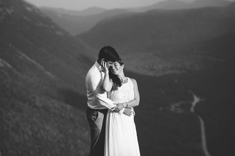 romantic wedding photo on top of a mountain. newlywed poses