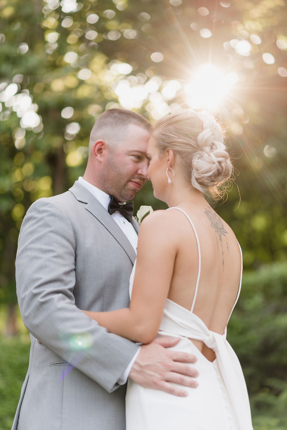 newlywed portrait with sun burst