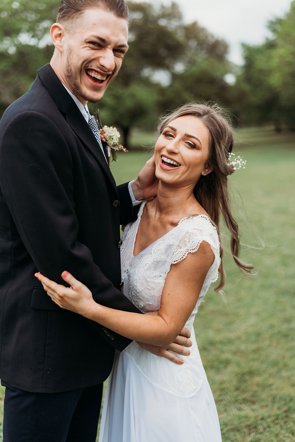 bride and groom are both looking at the camera laughing during their Austin elopement