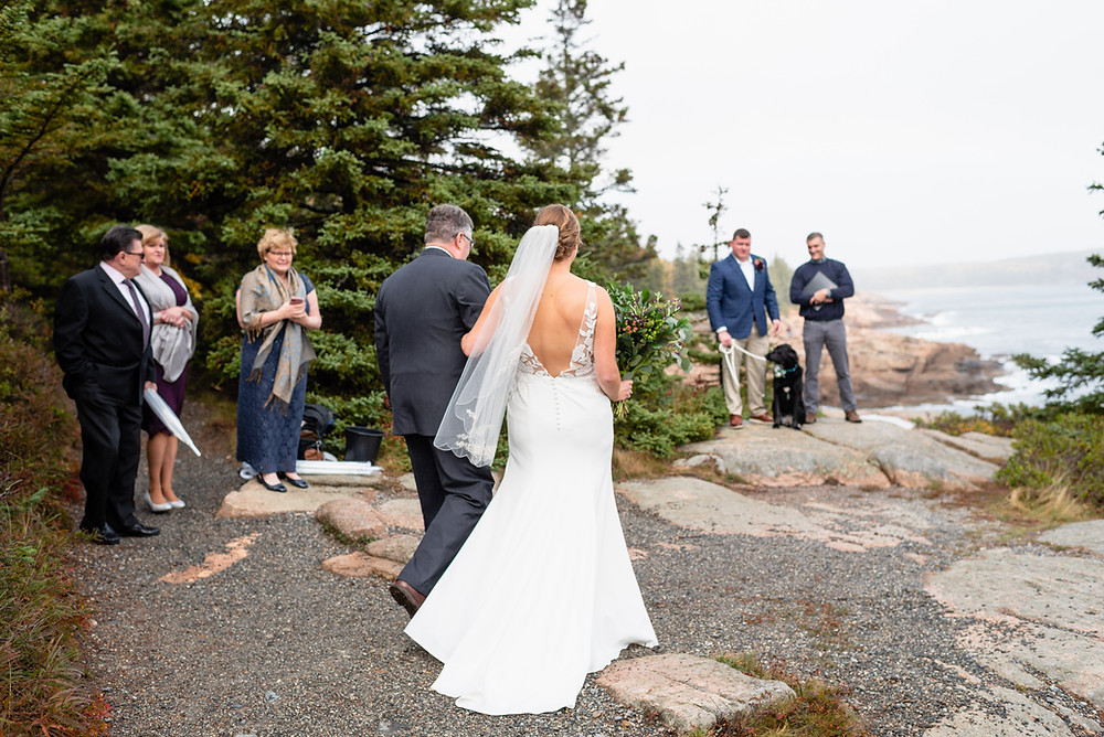 bride walking down aisle made out of a trail for elopement
