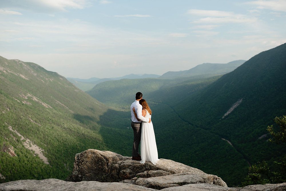 mount willard summit view. a couple looks out at the view during their elopement