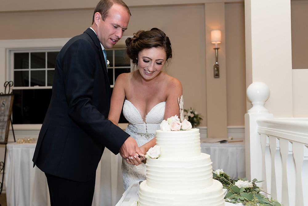 bride and groom cutting the wedding cake at brookside country club