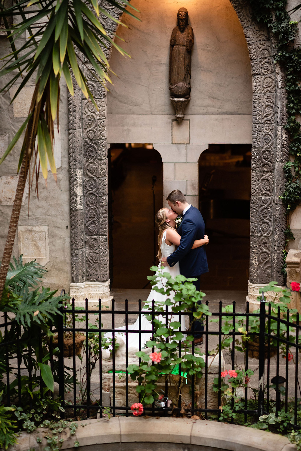 first kiss at elopement in courtyard of hammond castle museum