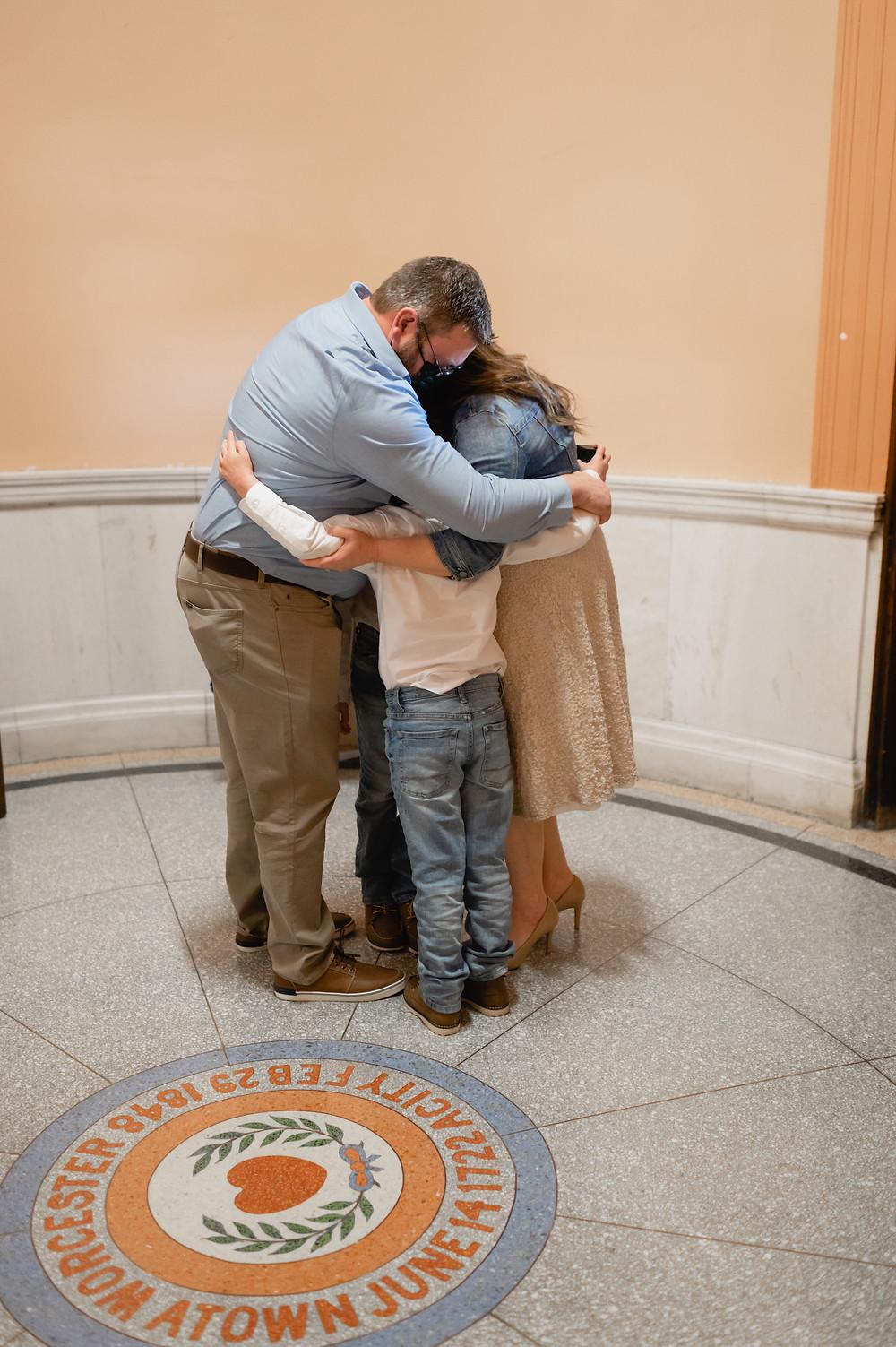 family hug after elopement