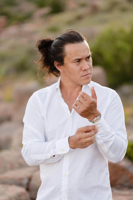 groom buttoning cufflinks