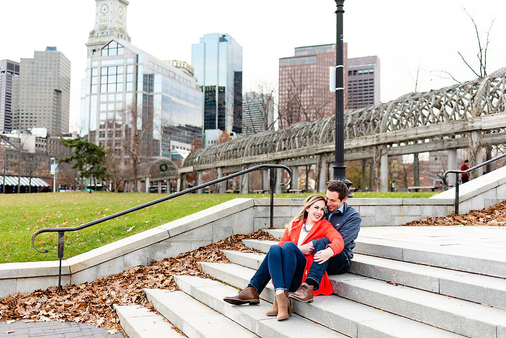 engagement photos on stairs at christopher columbus park