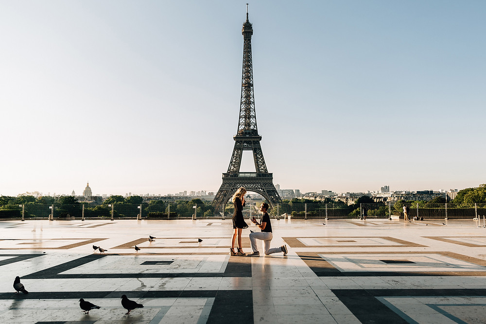 couple getting engaged in front of the Eiffel tower