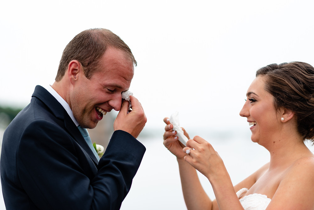 bride and groom crying during first look on dock in cape cod