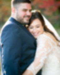 bride is snuggled into groom's chest with her eyes closed and a big smile. They are hugging after their wedding ceremony at valley view farm in haydenville, ma during the fall.