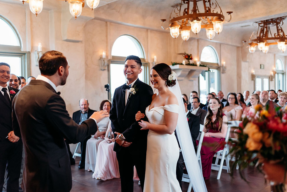 bride and groom smiling during ceremony at villa antonia chapel