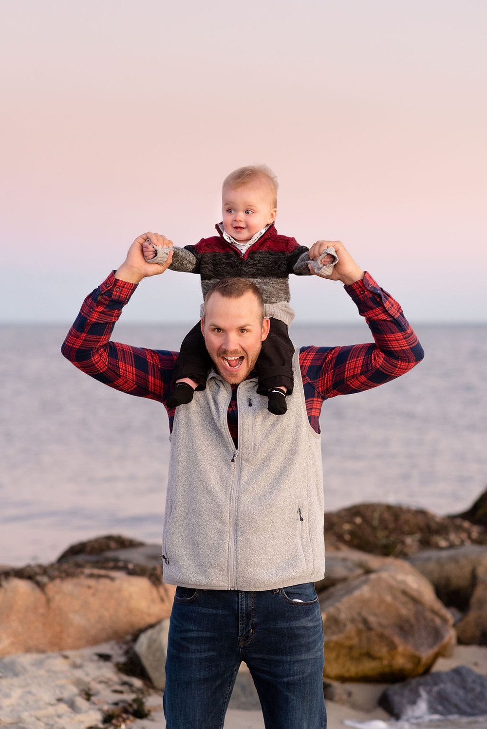 dad with son on shoulders for engagement photos at lighthouse inn in West Dennis Cape cod, MA
