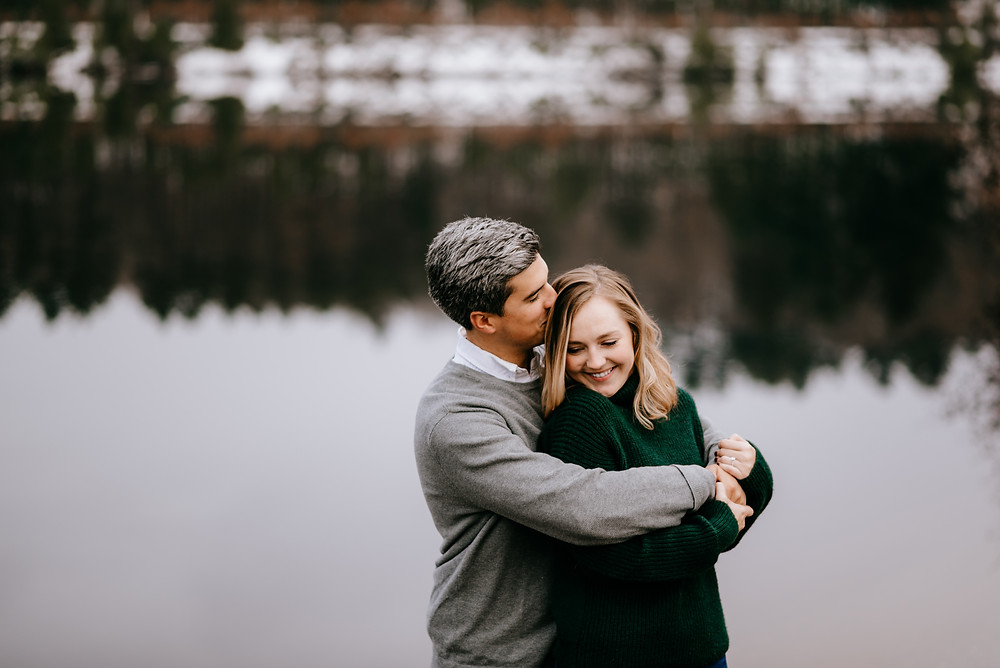 engagement photo on the lake by old stone church