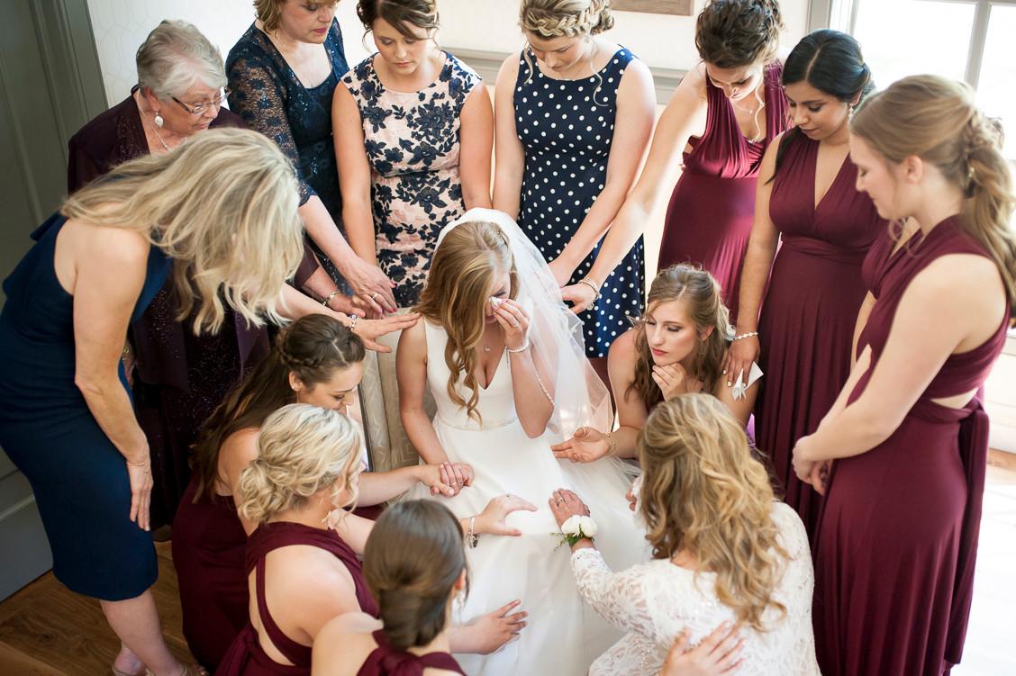 Bride tribe, group prayer before wedding