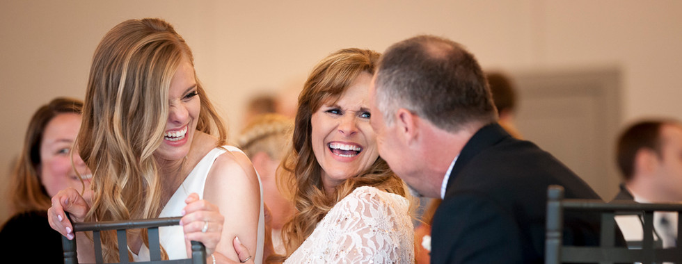 Candid wedding photography, bride with parents
