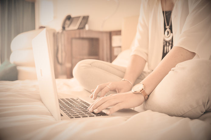 Laptop%20Typing%20on%20Bed_edited.jpg