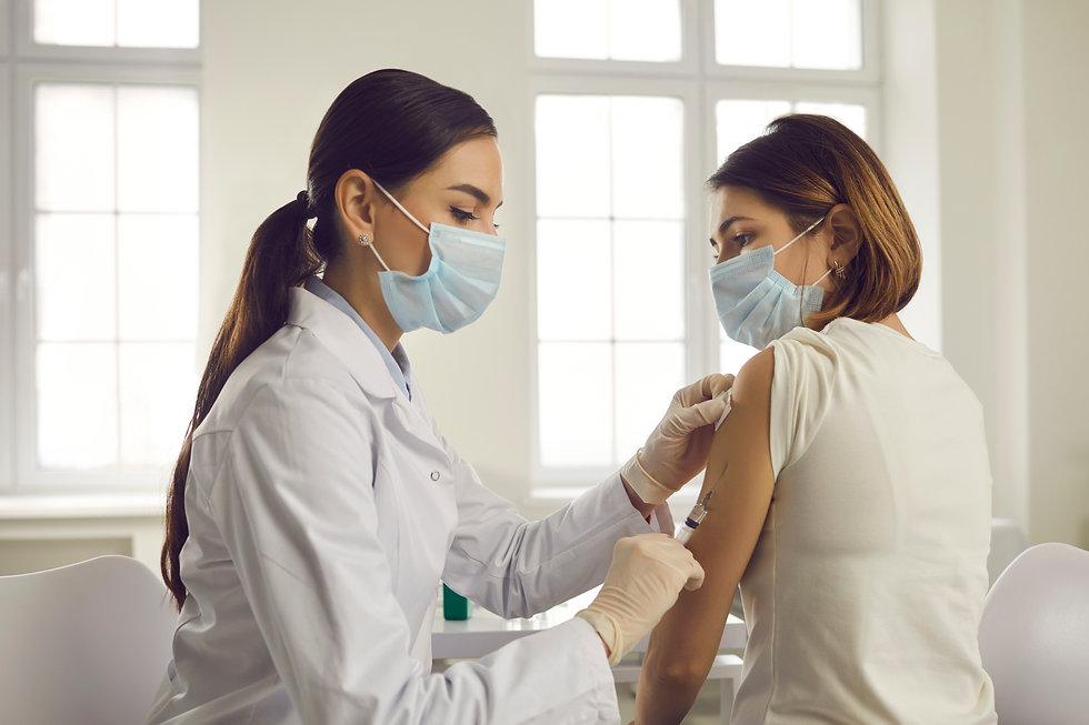 Professional doctor or nurse giving flu