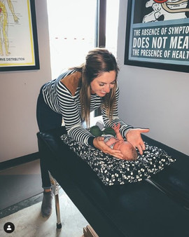 Dr. Amanda giving gentle chiropractic care to a newborn!