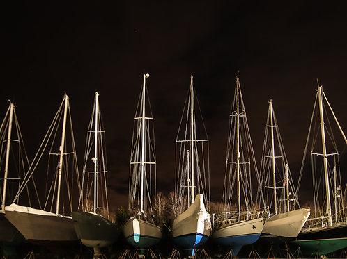 Masts of Sandwich Harbor at Night