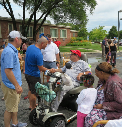 27013568_Tom Wheelchair wash 2017.JPG