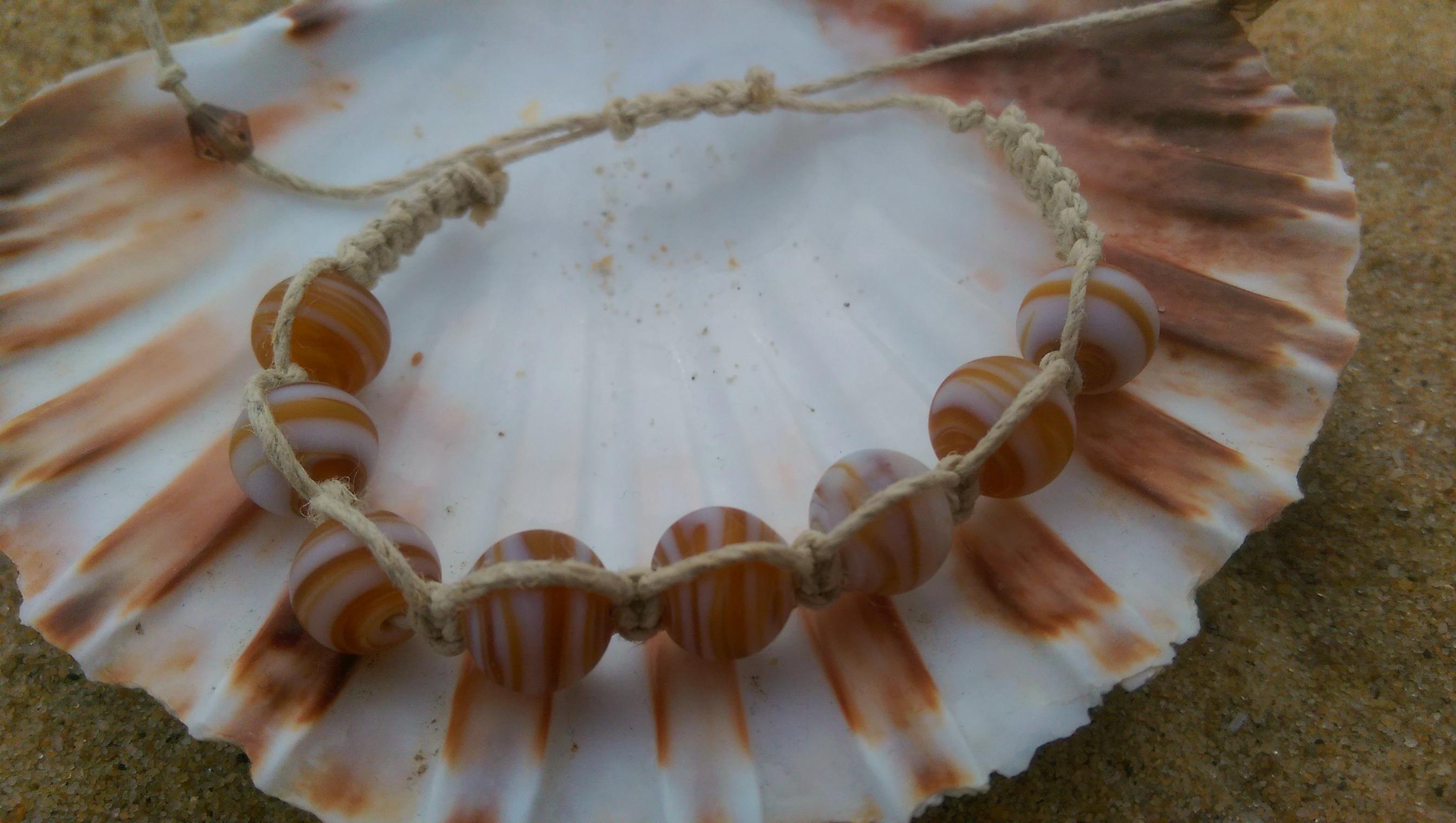Sand coloured shamballa-style