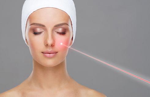 Doctor removing moles using laser ray. B