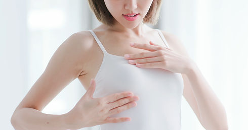woman check her chest at home -  Breast