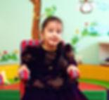 cute little girl in wheelchair at rehabi