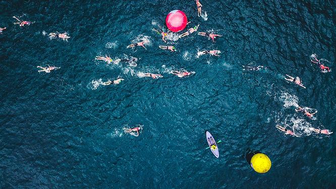 aerial-photo-of-people-swimming-on-sea-1