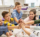 happy-children-making-high-five-at-robot
