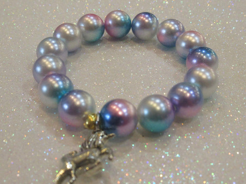 An Enchanting Unicorn Charm Bracelet With Ombre Gumball Beads Are 10 Mm