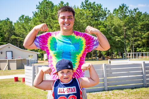 Flexing Arms Day Camp (Portrait).jpg