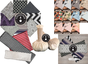 a circle made of square heat packs in different prints, 2 cherry pit massage bags, a set of fabric swatches, and a stack of long heat packs in different prints