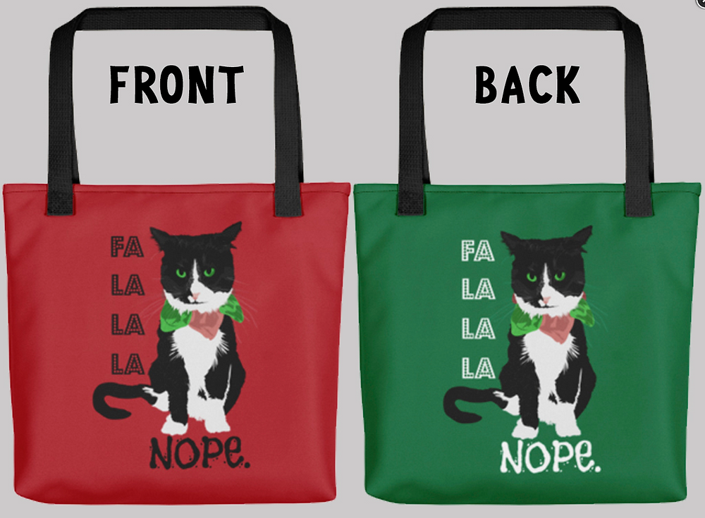"The front and back of a tote bag with black handle.  One side is red and the other gree.  On both sides is an annoyed looking black and white cat wearing a fabric red and green collar.  Text to the left reads, ""FA LA LA LA NOPE."""