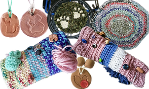 3 clay-based necklaces for dispensing essential oils, 2 hand-crocheted rim cozies, and 2 knitted, multi-color hand muffs with various buttons and balls and other texture pieces for stimming purposes.