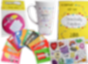 """A fan of multiple colored cards with illustrated spoon characters, a hand mirror with an ab-fab spoon charcter, a mug with motivational sayings on it, a calendar for the """"chronically fabulous"""" and a postcard"""