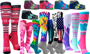 A photo of many different compression socks and leg sleeves.  Patterns range from red black and white abstracts, to tie-dye, to bright cheerful colors, american flags, skulls and a lightening strike.  There are also ankle-height compression socks in contrasting colors.