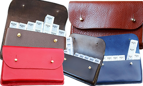"5 handmade leather cases with top flap closures for holding pill cases.  Superimposed is a bage that reads: ""For 10% off Pill Cases,use: PRETTYSICK"""