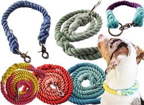 3 coiled lenths of braded rope in different colos, with leah attachments at he ends.  A small length of similar rope in blue with leash attachmet clasps at both ends.  A collar made of the same materia, and a semi-coiled leash in green.