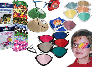 2 sets of colored eyepatches, one with black accents and one with white.  2 boxes of Ortopad listed as for boys and for girls and spread out differsnt patterns.  A child wearing glasses with a rainbow patterned patch over one eye.